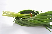 Garlic chives, tied in a knot