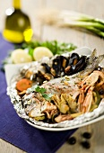 Sea bream with shellfish cooked in foil
