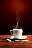 A steaming coffee cup