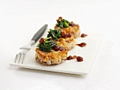 Salmon fish cakes with raisin sauce