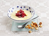 Lemon soup with raspberries and almond biscuits
