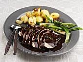 Roast pork with blackcurrant sauce & spring onions (Sweden)