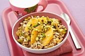 Muesli with pistachios and orange segments