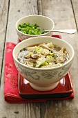 Asian soup with pork, cabbage, mushrooms and spring onions