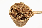Dried silk tree flowers (Albiziae flos, He huan hua) in tea strainer
