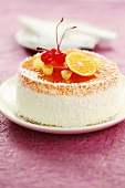Cheesecake with fruit jelly, coconut and fruit