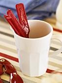 Lobster cracker and lobster forks in a mug