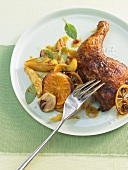 Marinated chicken legs with orange slices