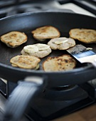 Frying banana pancakes in a frying pan