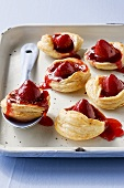 Strawberry puff pastry tarts on baking tray
