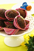 Chocolate muffins in coloured paper cases