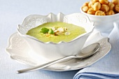 Cream of courgette soup with toasted almonds and basil