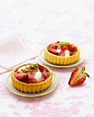 Two individual strawberry flans