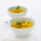 Two bowls of saffron rice with rosemary