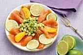 Smoked salmon with avocado, lime slices & orange segments