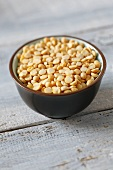 Yellow split peas in a small bowl