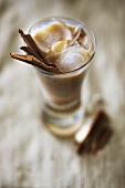 Baileys with ice cubes and cinnamon sticks