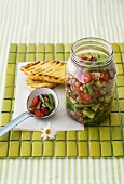 Bean, onion, cucumber and tomato salad in jar and ladle