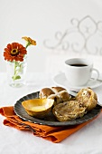Breakfast in bed: hot cross buns, butter and coffee