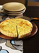 Cheese and herb tart, a piece cut