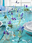 Turquoise table with spring flowers