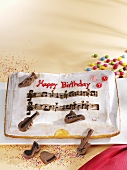 Birthday cake with chocolate musical instruments