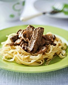 Beef and mushrooms on ribbon pasta