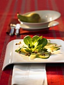 Avocado carpaccio with corn salad and pine nuts