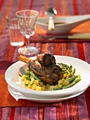 Braised lamb shank on potatoes and beans