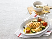 Grilled chicken breast with vegetables and white wine