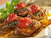 Baked turkey steaks with red pesto, basil and tomatoes