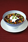 Bean stew with sour cream and mint