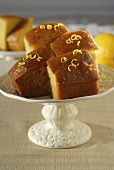 Several pieces of citrus cake on cake stand