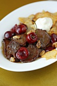 Venison ragout with cherries and nuts