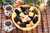 Melon and blackberry salad with icing sugar