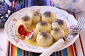 Sweet dumplings with berry filling and poppy seeds