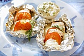Salmon with tomatoes and feta baked in aluminium foil