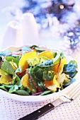 Baked pumpkin slices on corn salad