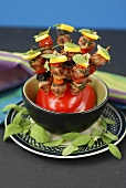 Grilled mixed kebabs, stuck into a pepper