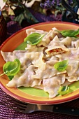 Ravioli with cheese filling and basil