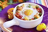 Fried egg on ham and vegetable ragout for Easter (Spain)