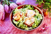 Salmon rolls with egg on green salad for Easter