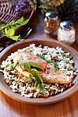 Chicken breast on rice with nuts and herbs