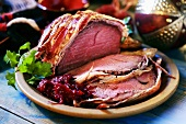 Bacon-wrapped roast beef, partly carved