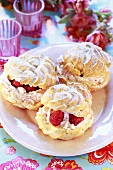 Profiteroles with raspberry cream filling