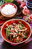 Strips of pork with green beans and nuts, rice