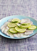 Onion salad with cucumber and lime slices and chillies