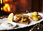Deep-fried fish with potatoes and dill mayonnaise