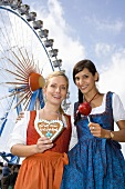 Two women in front of big wheel (Oktoberfest, Munich)