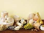 Cheese still life with grapes, pears and walnuts
